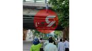 نامه ای در جیب جوان حلق آویز شده در میدان شیرازی کرمانشاه + عکس